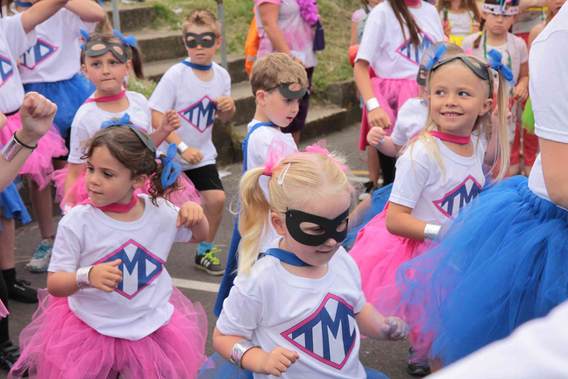 Children in costume for a super hero dance party