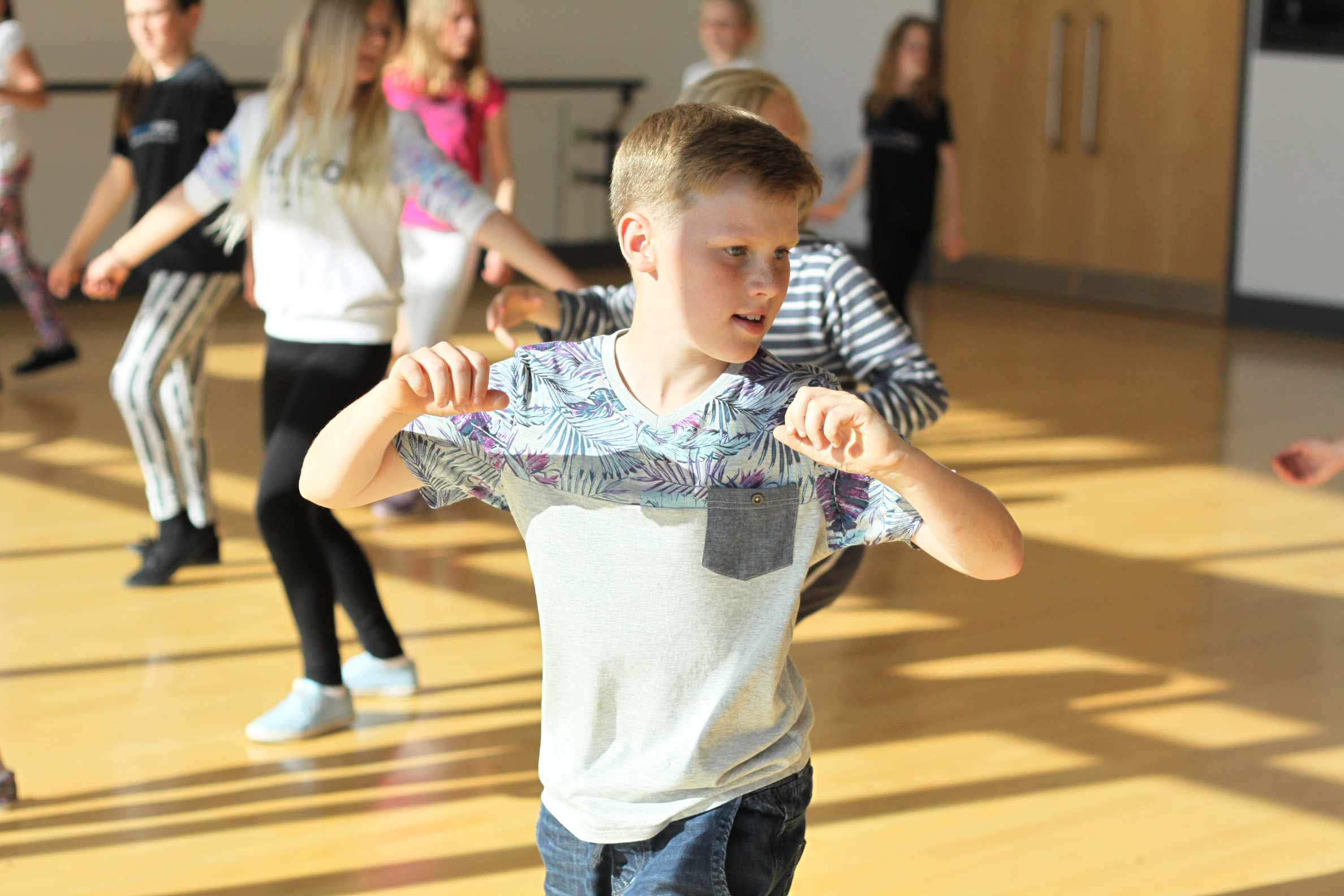 Boy dancing at children's dance party