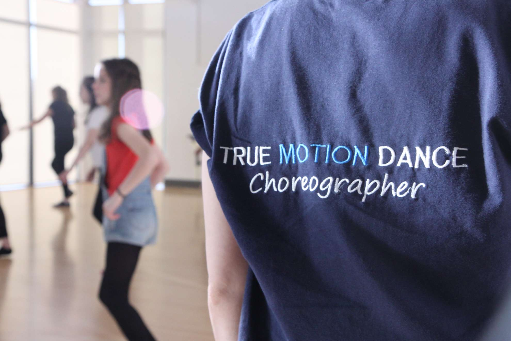 Choreographer in dance class