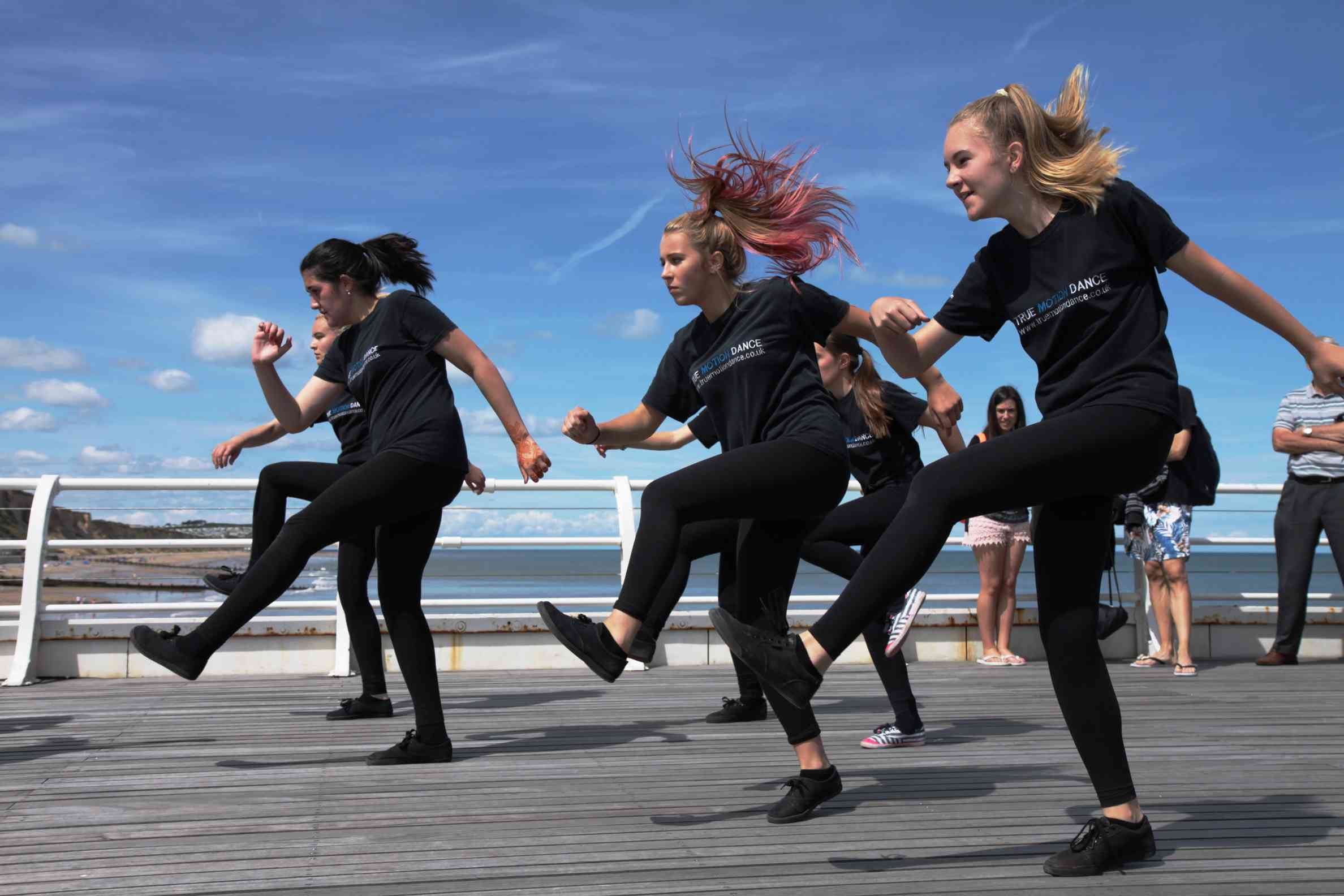 Girls dancing on Cromer Pier