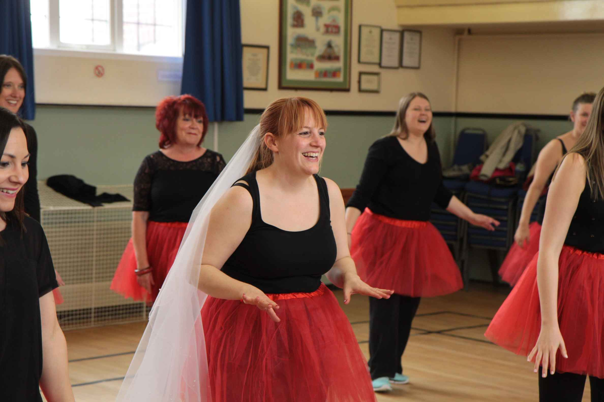 Bride to be and her hens at a musical themed hen dance party