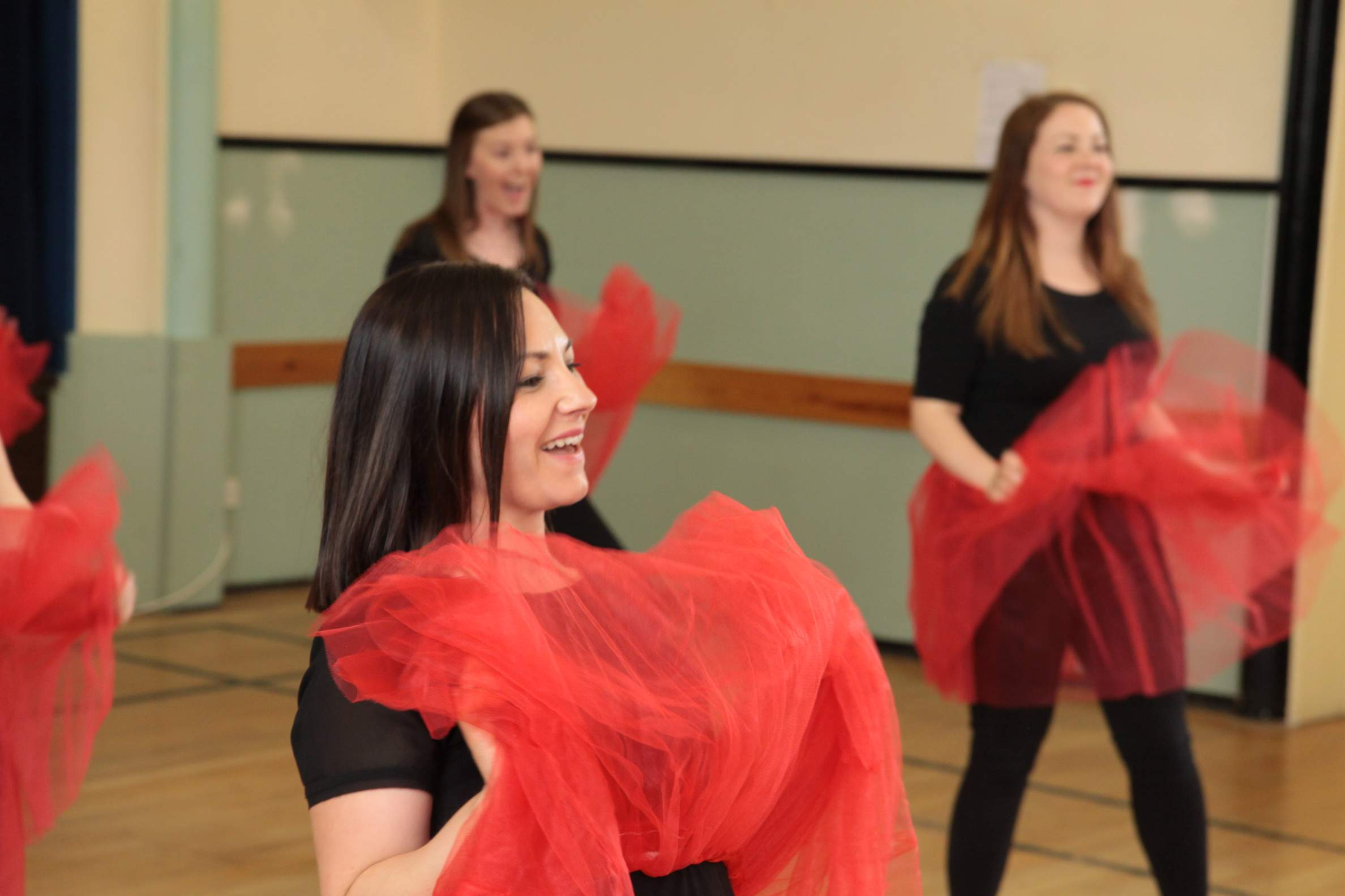 Hens laughing and dancing at their hen dance party