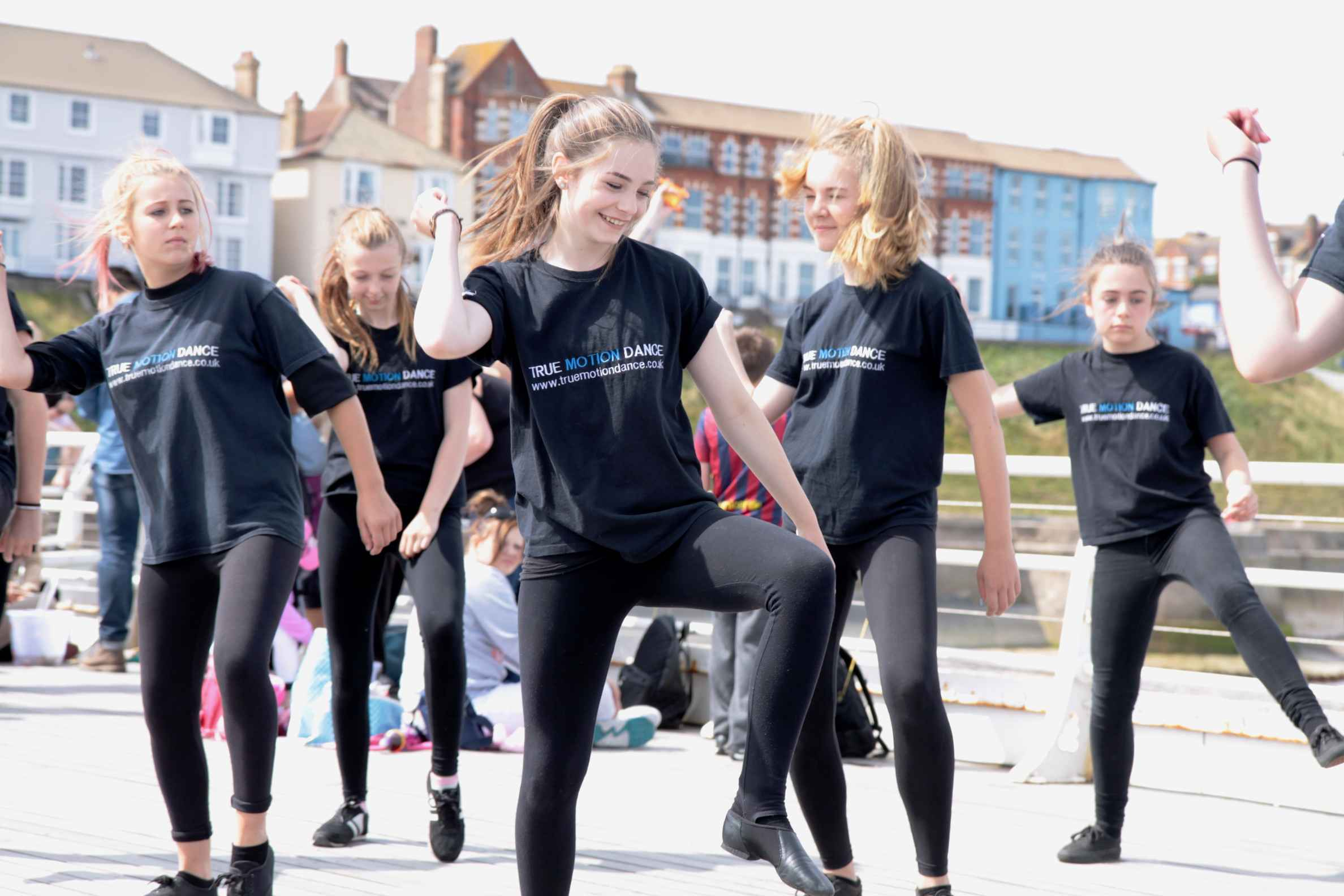 Girls dancing as part of holiday dance club