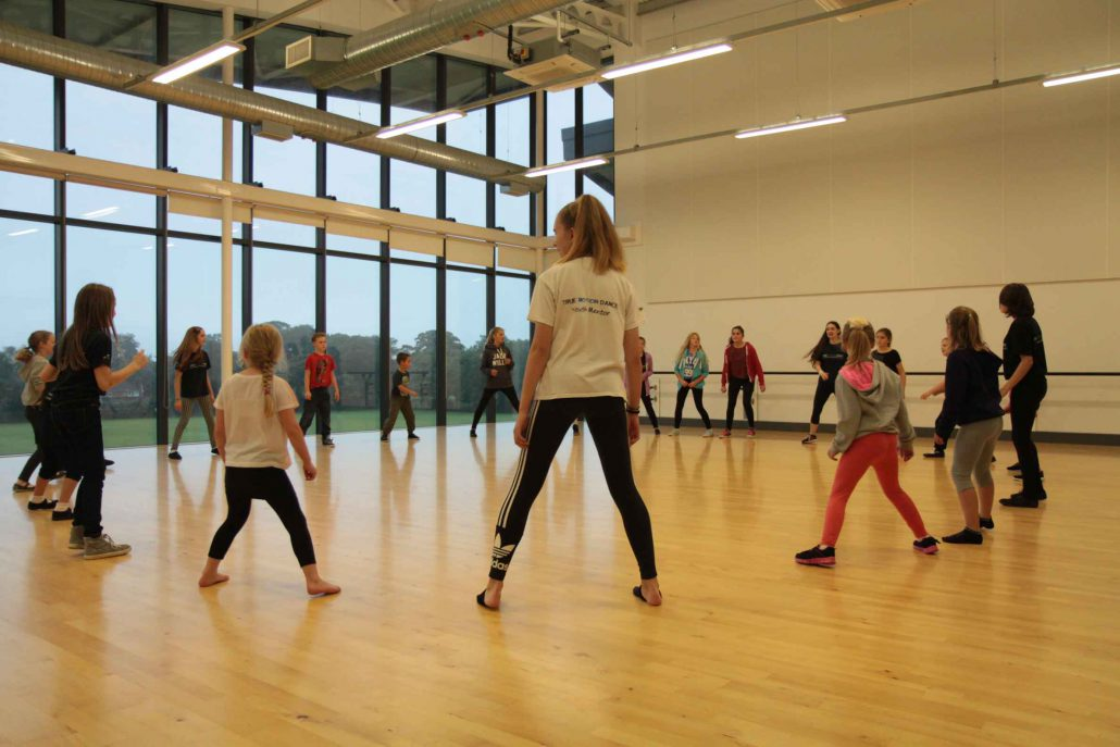 Youth mentors assisting in street dance (ages 8-11) dance class in North Norfolk