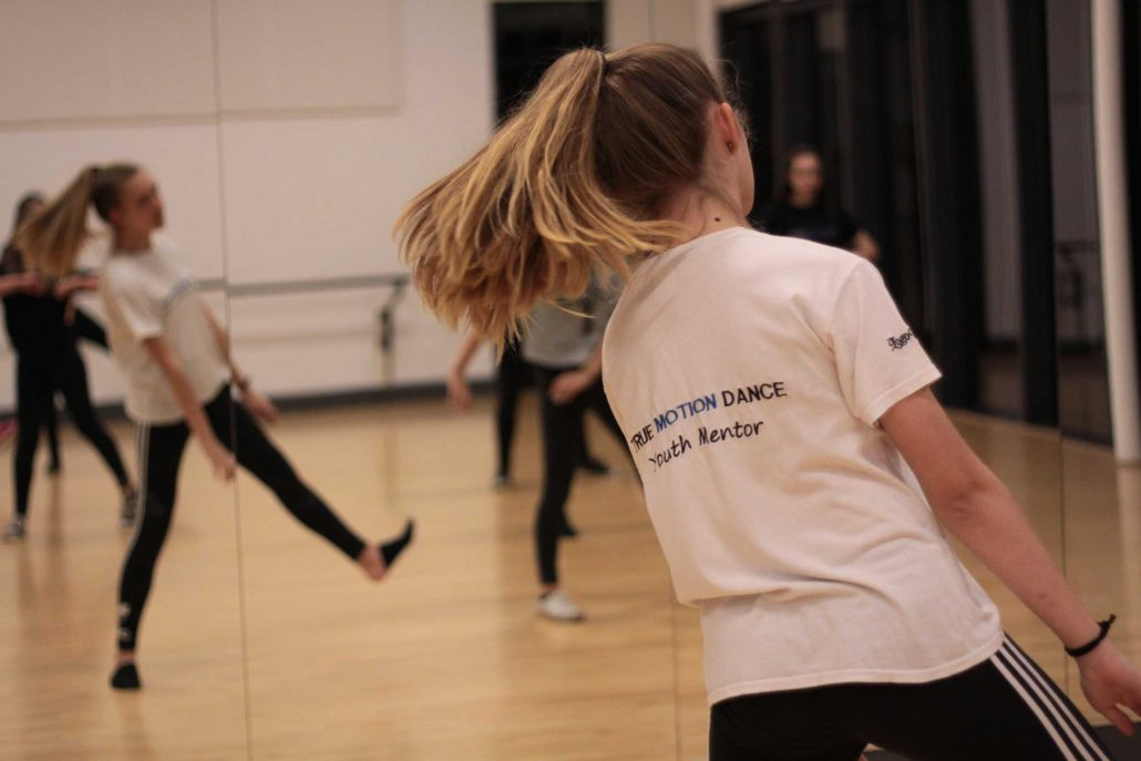 Youth mentors assisting in dance class