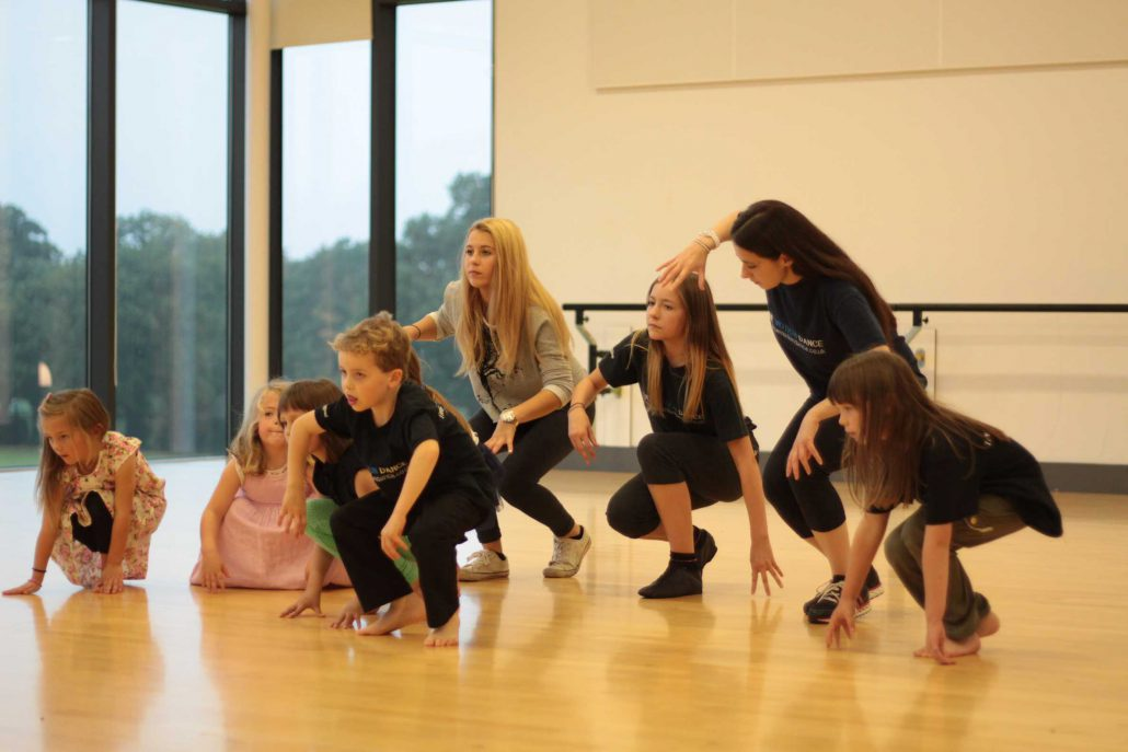 Youth mentors assisting in mini movers (ages 4-7) dance class in North Norfolk
